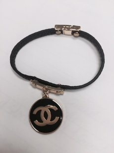 Chanel Chanel authentic CC gold and black focal pice bracelet with leather look strap -SUPER CUTE- French runway couture*