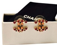 Chanel Chanel Gold CC Logo Pierced Earrings with Purple and Red Poured Glass