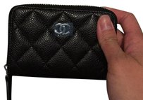 Chanel Chanel zippy coin purse in black caviar leather and silver hardware