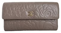 Chanel RARE! CHANEL Camellia Embossed Lambskin Flap Wallet