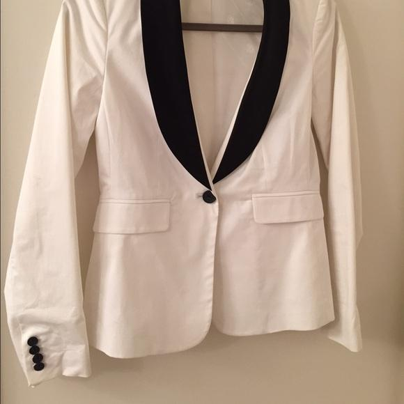 Our black and white women's tuxedo jackets is perfect for wedding, prom, black tie or any occasion. Designed to hug and accent all the right places these jackets offer effortlessly cool style in peak lapel and shawl collar. Order online at Little Black Tux.