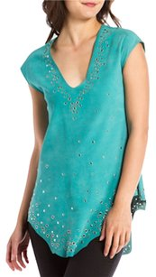 Donald J Pliner Featuring silver studs and rivets at the neckline and bottom hem with a few scattered throughout. This tunic looks great paired with skinny jeans. Pullover Bust 34