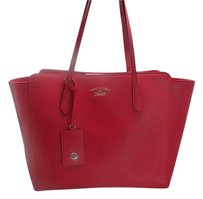 Gucci Pebbled Calfskin Swing Tote in Red