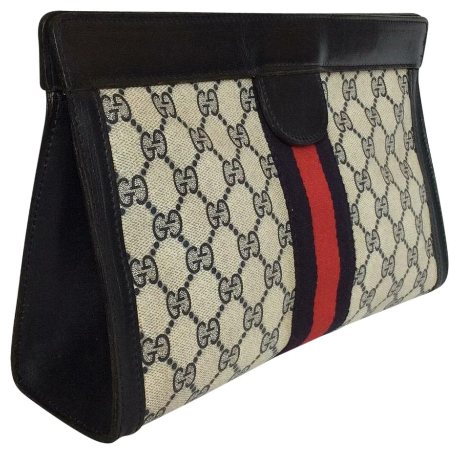 gucci clutch. gucci blue/red clutch c
