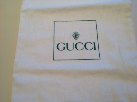 Gucci Two Gucci shoe covers