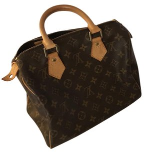 Louis Vuitton Satchel in golden metallic