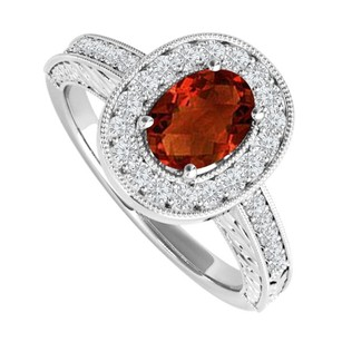 LoveBrightJewelry 2 Ct Oval Garnet And Cubic Zirconia Engagement Ring