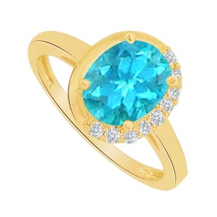 LoveBrightJewelry Blue Topaz And Cz Half Halo Ring In 14k Yellow Gold