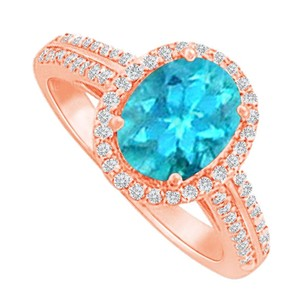 LoveBrightJewelry Halo Ring With Blue Topaz And Cz In Rose Gold Vermeil