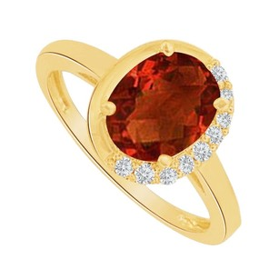 LoveBrightJewelry Oval Garnet And Cz Half Halo Ring In 14k Yellow Gold