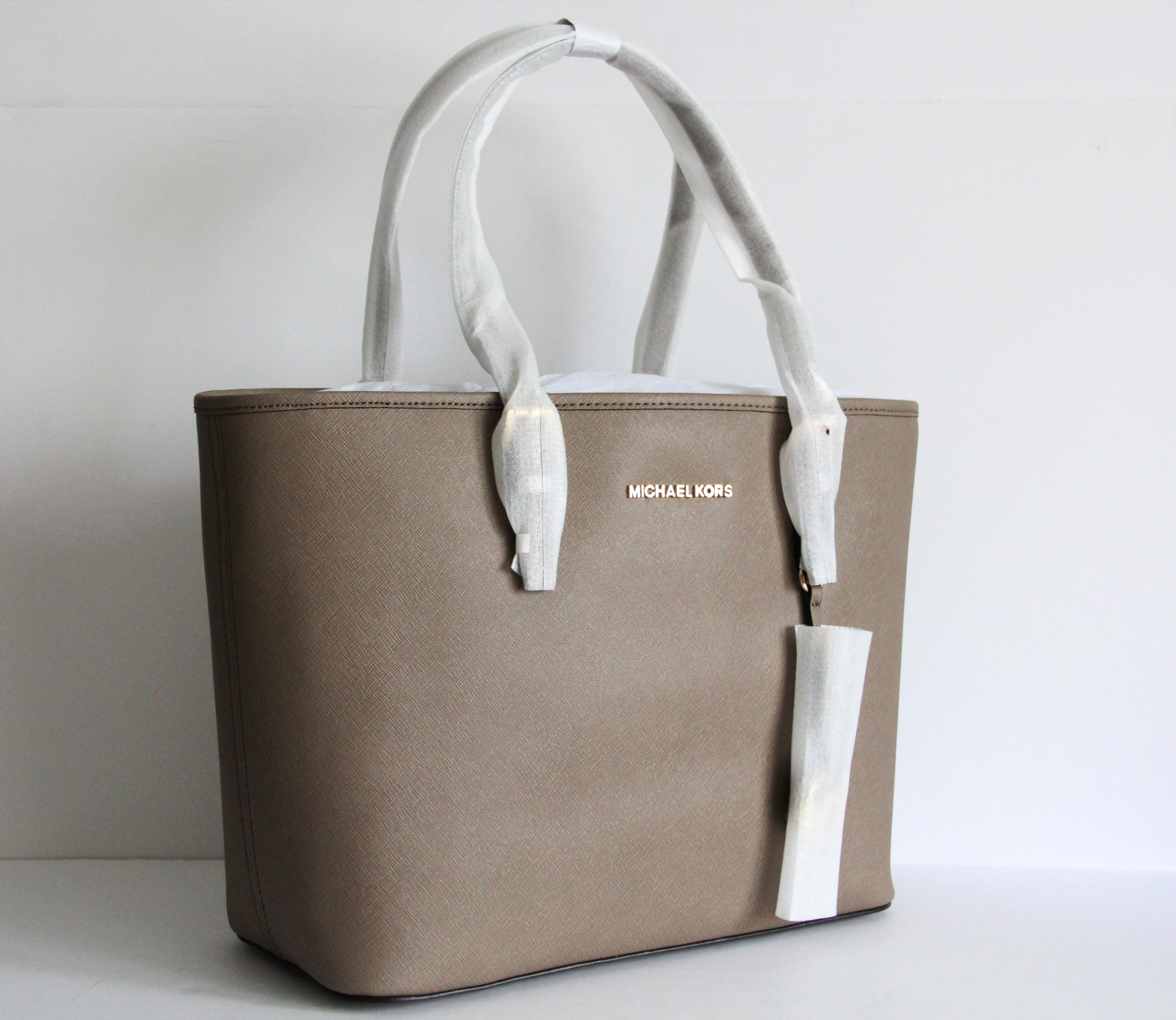 5e025cf255f6c6 ... norway michael kors travel leather taupe tote in dark dune. 123456789  588ba 2aa64 best price michael kors jet set ...