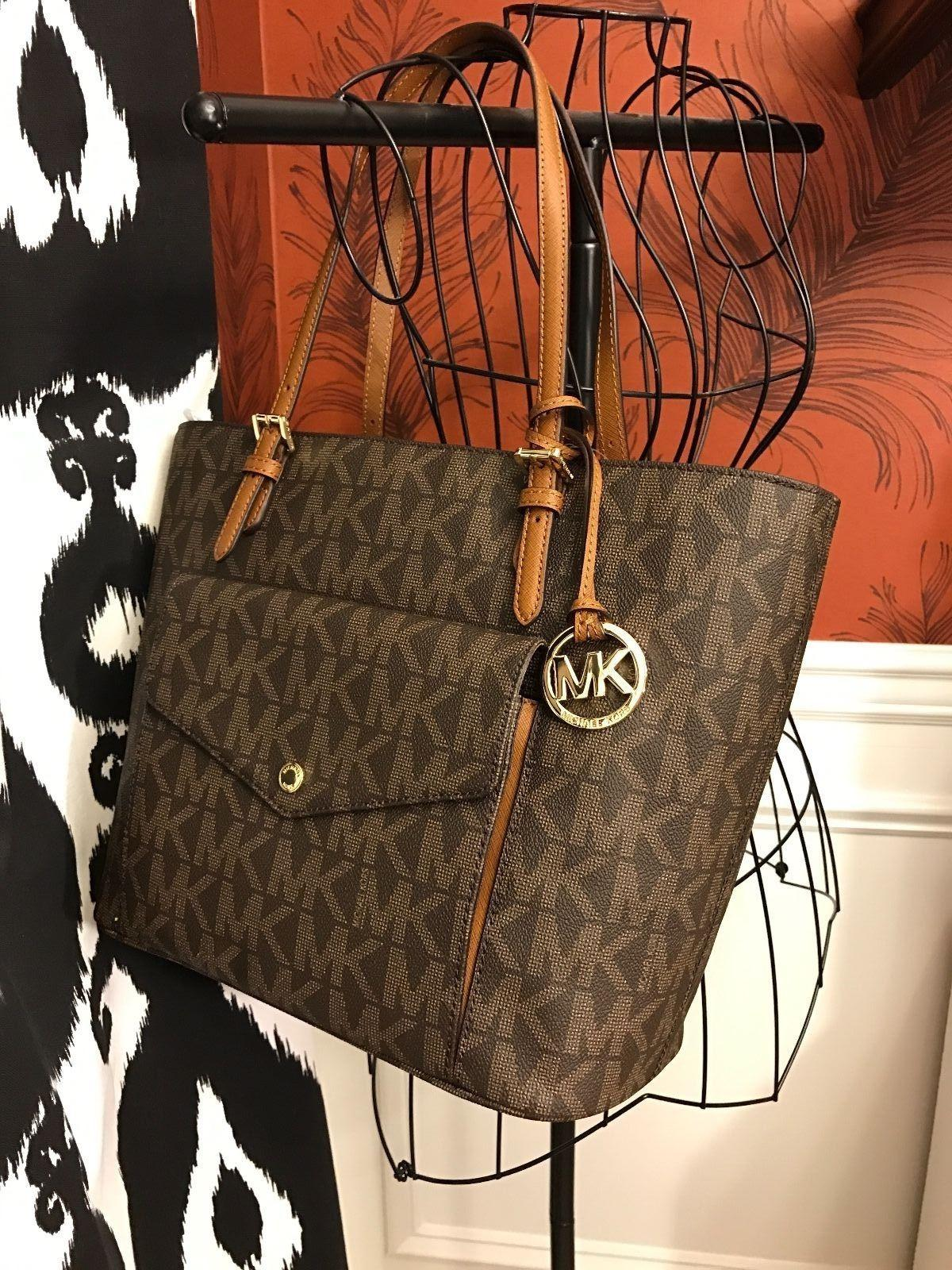 e93009352ba2 Michael Kors Brown Signature Canvas Jet Set Item Large Pocket Multi  Function Tote - Tradesy