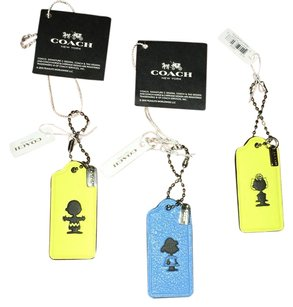 NWTs Coach X Peanuts HangTags Snoopy Limited Edition Wristlet in NWTs Yellow / Blue Not A