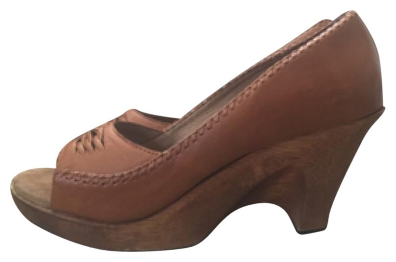 On trend boho Michael Kors tan/brown 70's clog styled wooden wedges.  Perfect w/denim.