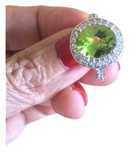 10K Rose Gold 3.50ct Oval Manchurian Peridot with .71ctw White Zircon Ring Sz6