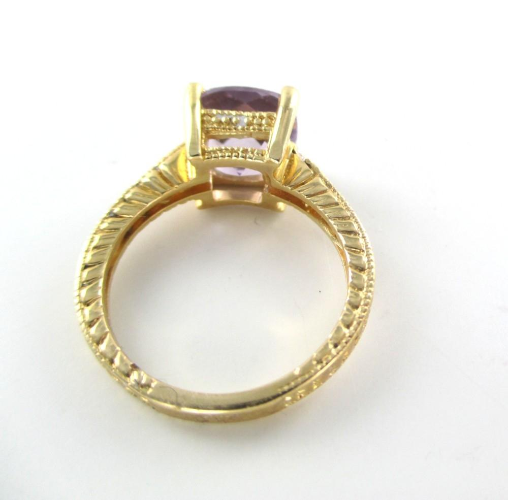 14K SOLID YELLOW GOLD RING 8 DIAMONDS 25 CARAT SZ 7 PURPLE STONE