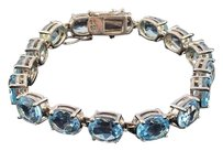 Sky Blue Topaz Cut Ovals 16 Set In Sterling Silver 925 Tennis Bracelet 8