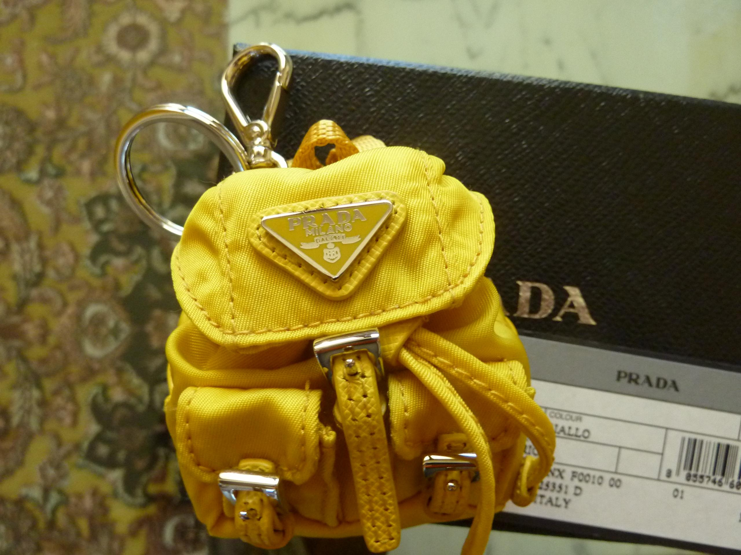 47b19d6413 coupon for prada backpack keychain yellow a9f7f ac8e4