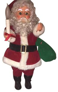 Trim Home 24 inch animated santa with moving arm carrying lighted-candle.